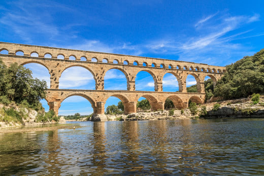 The Pont du Gard from the riverbank in Nimes, France.