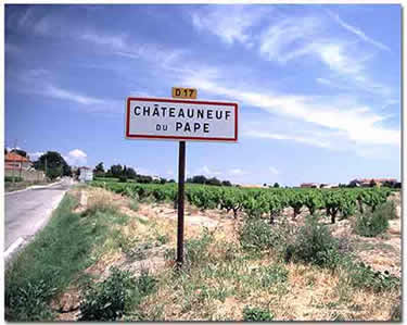 A sign on the road leading to the town of Châteauneuf-du-Pape.