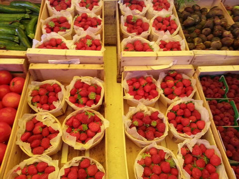 Baskets of strawberries at a market in Provence, France.