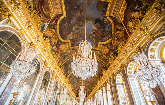 A crystal chandelier in the Hall of Mirrors at Versailles castle.