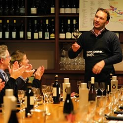 A sommelier leads a wine tasting class in Paris, France.