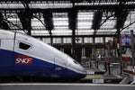 Load image into Gallery viewer, A TGV train at a rail station in Paris, France.