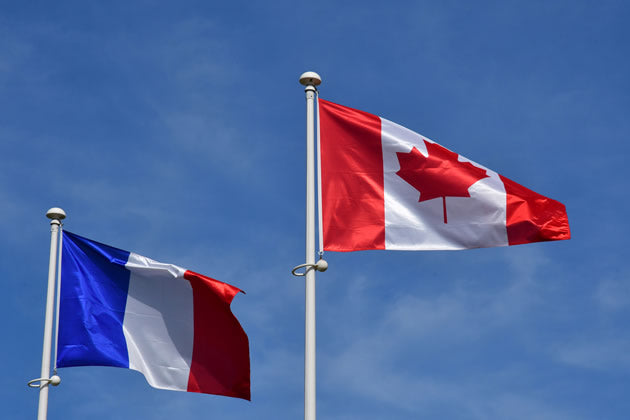 The Canadian and French flag flying together in Normandy, France.