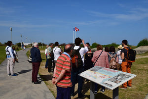 Tourists listen to a guide at the Juno Beach Centre.