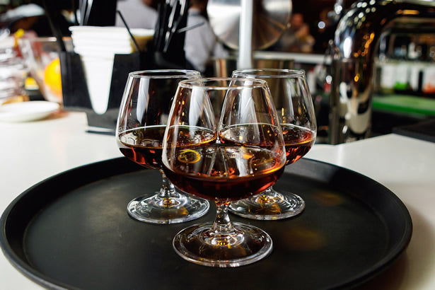 Glasses of cognac on a tray.