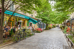 A quaint tree lined street in the Marais district of Paris.