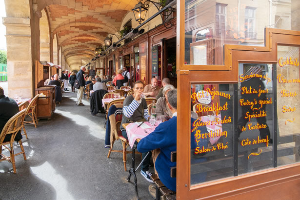 Diners in the charming Marais district of Paris.
