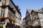 Load image into Gallery viewer, Half-timbered houses in the medieval city of Dinan, France.