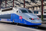 Load image into Gallery viewer, A TGV train bound for the city of St. Malo sits at Gare Montparnasse in Paris.