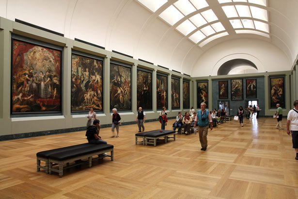 A sunlit gallery inside the Louvre museum.