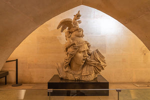 """The Genius of War"" statue inside the Louvre museum in Paris, France."