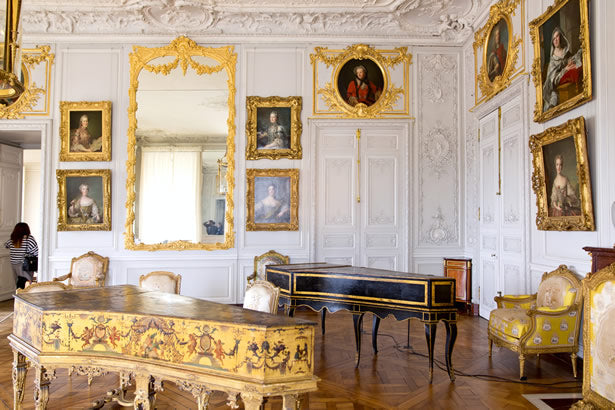 A salon with classical instruments inside Versailles.