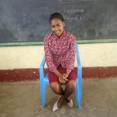 Jackline is now giving back to her community as a teacher