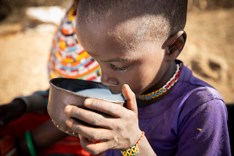 Boy in Kenya drinking milk