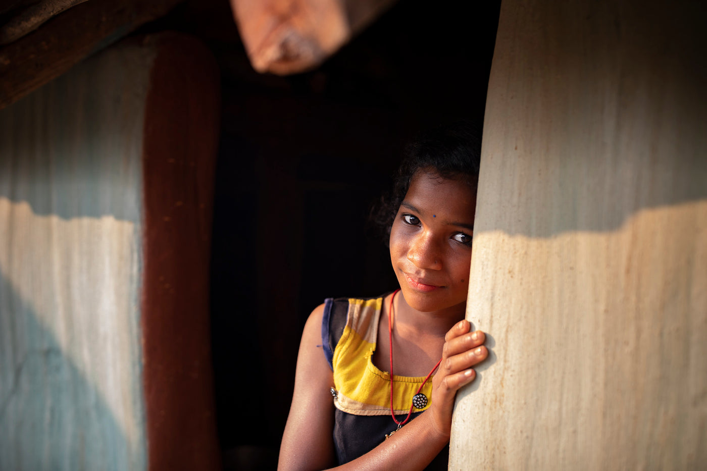 Rina looks out her door during India Covid crisis
