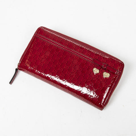 Gucci  heart ribbon zip Around Wallet.