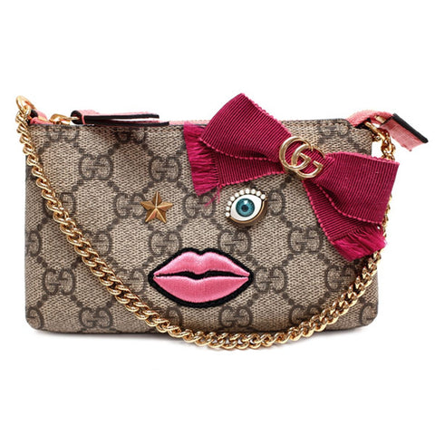 Gucci GG Supreme Mini Handbag Pouch.