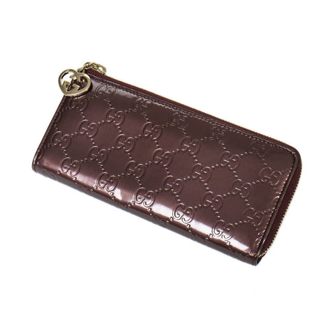 Gucci Twin Heart zip around wallet  Guccissima Leather.