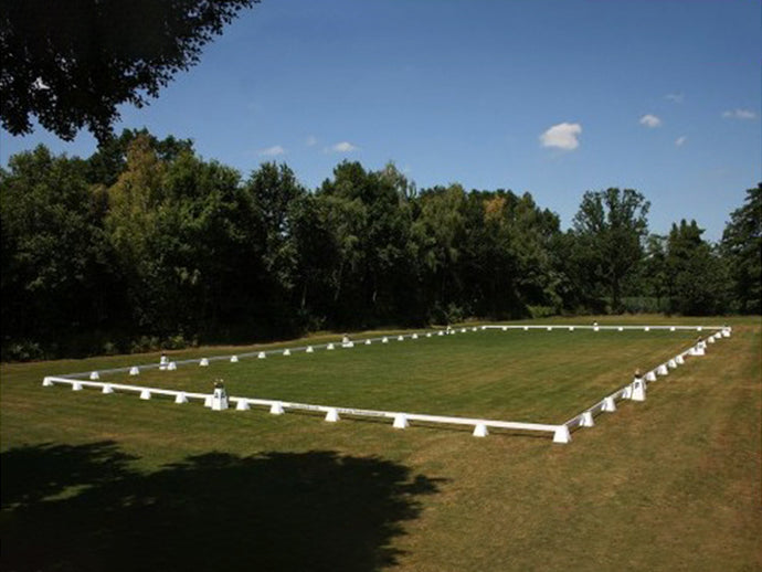 Photograph of Dressage Arena, 20 by 40 metres in field, complete with Dressage Tower Markers.