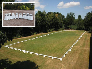 Photograph of Dressage Arena, 20 by 60 metres in field, complete with Dressage Tower Markers. Option includes 8 Dressage Tower Markers.