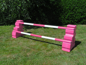Photograph of a pair of Pink MultiJumps with 2 5 Band Practice Poles coloured: Pink & White.
