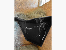 Load image into Gallery viewer, Black Hay Feeder attached to wall inside stables.