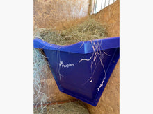 Load image into Gallery viewer, Blue Hay Feeder attached to wall inside stables.