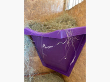 Load image into Gallery viewer, Purple Hay Feeder attached to wall inside stables.