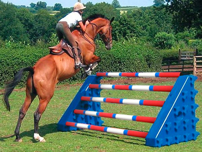 Horse and rider jumping over Blue Combi Blocks with 5 9 Band Poles.
