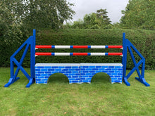 Load image into Gallery viewer, Photograph of a pair of Blue Cross Wings with 2 9 Band Practice Poles coloured: Red, Blue & White. Underneath the poles sit 2 White Bridge Fillers with Blue Brick Graphics on them.