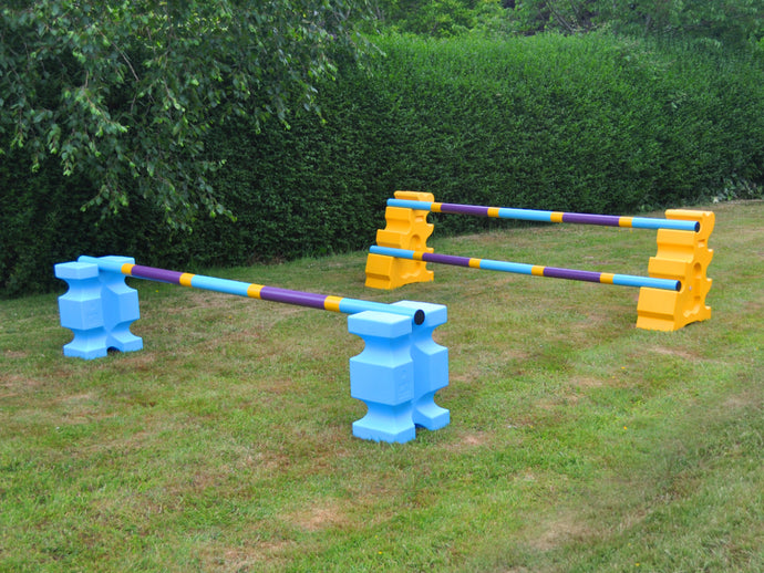 2 fences, from left to right. Pair of Baby Blue PolyJump Blocks with 1 9 Band Practice Poles Club Style. 1 Pair of Yellow MultiJumps with 2 Club Style Poles.