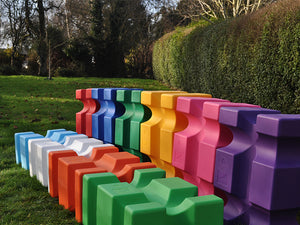 Collection of PolyJump Blocks of all different colours in field.