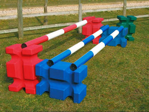 Collection of multi coloured PolyJump Blocks. Each with a matching coloured pole on top.