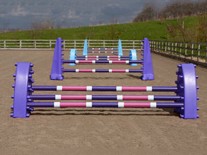 4 fences, from front to back: 1 pair of purple Hedgehogs with 3 Pro Poles, 9 Band coloured: Purple, White & Pink. 1 pair of Purple 8 Cups with 2 more poles. 1 pair of Baby Blue Hedgehog Jumps with 3 Poles and 1 set of Baby Blue 8 Cups with 2 more Pro Poles.