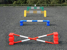 Load image into Gallery viewer, 4 rows of jumps. From front to back is a red pair of PolyJump Blocks with 2 5 band red and white poles. Behind that fence is the same in blue. Then a pair of yellow MultiJumps with 2 yellow and white 5 band poles. Finally a pair of green MultiJumps with green and white poles.