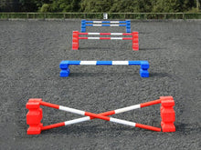 Load image into Gallery viewer, 4 rows of jumps. From front to back is a red pair of PolyJump Blocks with 2 5 band red and white poles. Behind that fence is the same in blue. Then a pair of red MultiJumps with 2 red and white 5 band poles. Finally a pair of blue MultiJumps with blue and white poles.