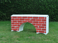 Load image into Gallery viewer, Photograph of a White Bridge Filler with a Red Brick graphic.
