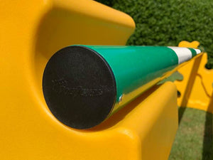 A close up of the end cap of a Green & White 5 Band Practice Pole, sitting on 2 Yellow MultiJumps. End cap embossed with PolyJumps' Logo.
