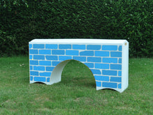Load image into Gallery viewer, Photograph of a White Bridge Filler with a Blue Brick graphic.