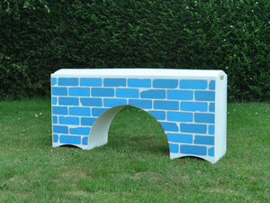 Photograph of a White Bridge Filler with a Blue Brick graphic.