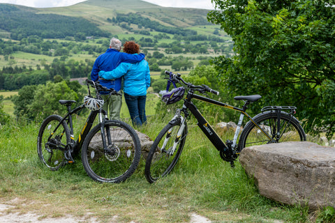A couple and their electric bikes