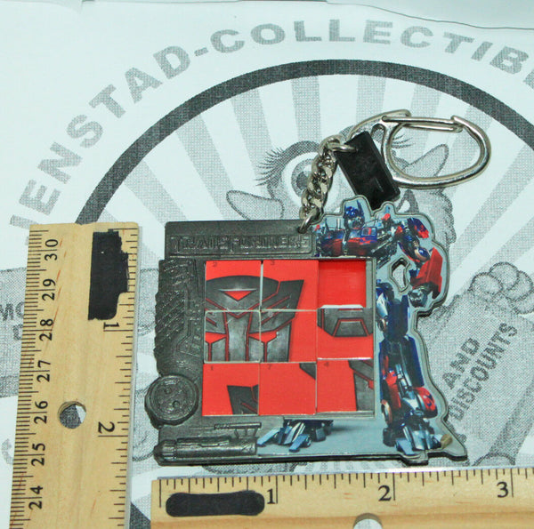 TRANSFORMERS MINIATURE SLIDE TOY PUZZLE KEYCHAIN AUTOBOT SYMBOL USED 2007 - EZ Monster Deals