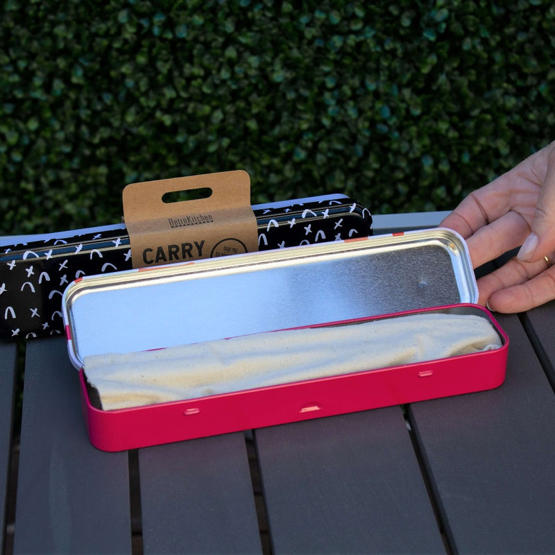 Personal cutlery set - showing the metal box opened showing the contents which is a linen bag holding the cutlery