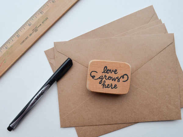 Love Grows Here Stamp- Hand Carved