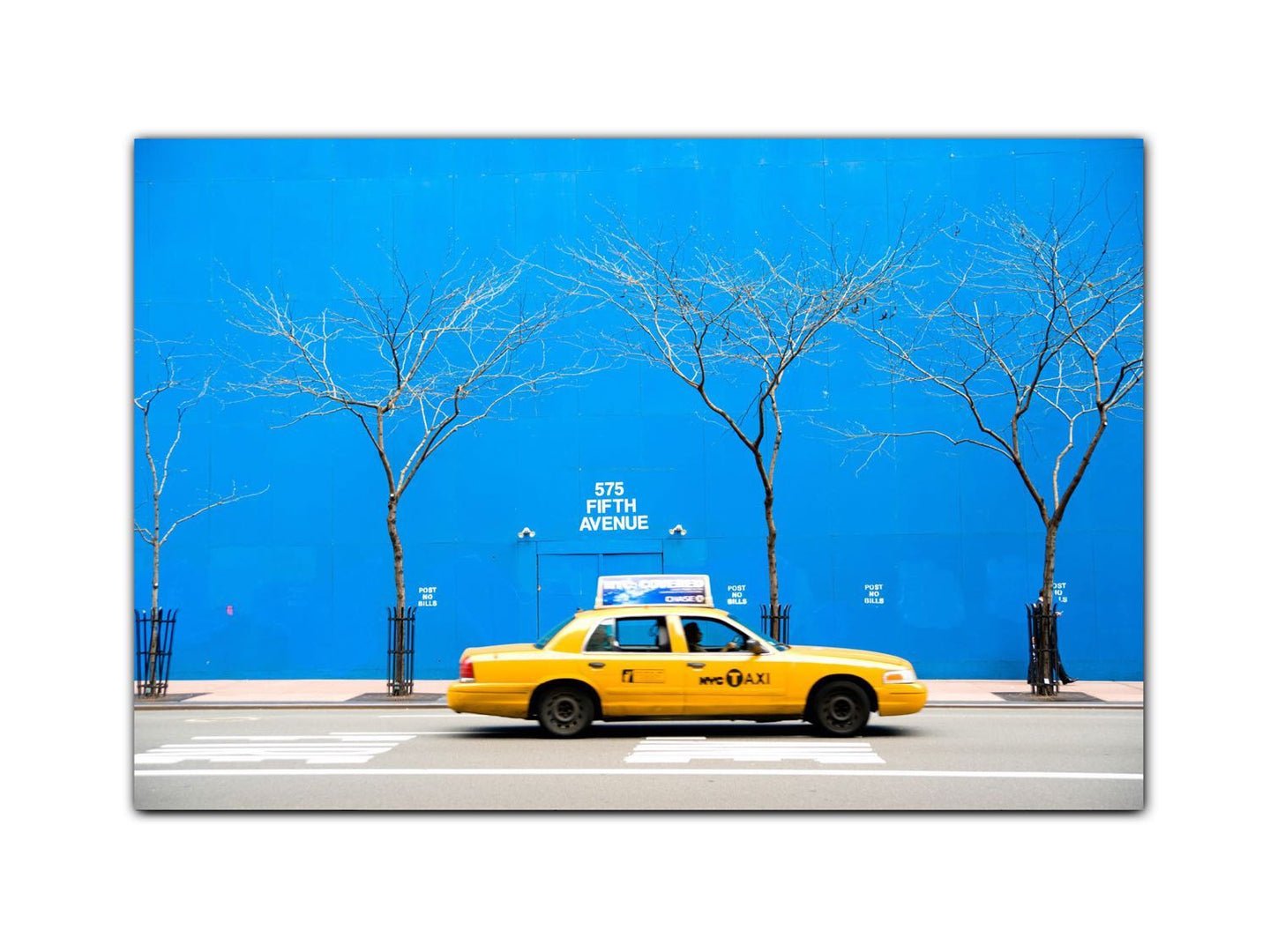 Yellow cab in blue city