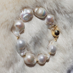 Exquisite quality of baroque pearls used for this bracelet is sufficient for the elegance and style. Finished with gold plated silver magnetic clasp and gold plated silver beads