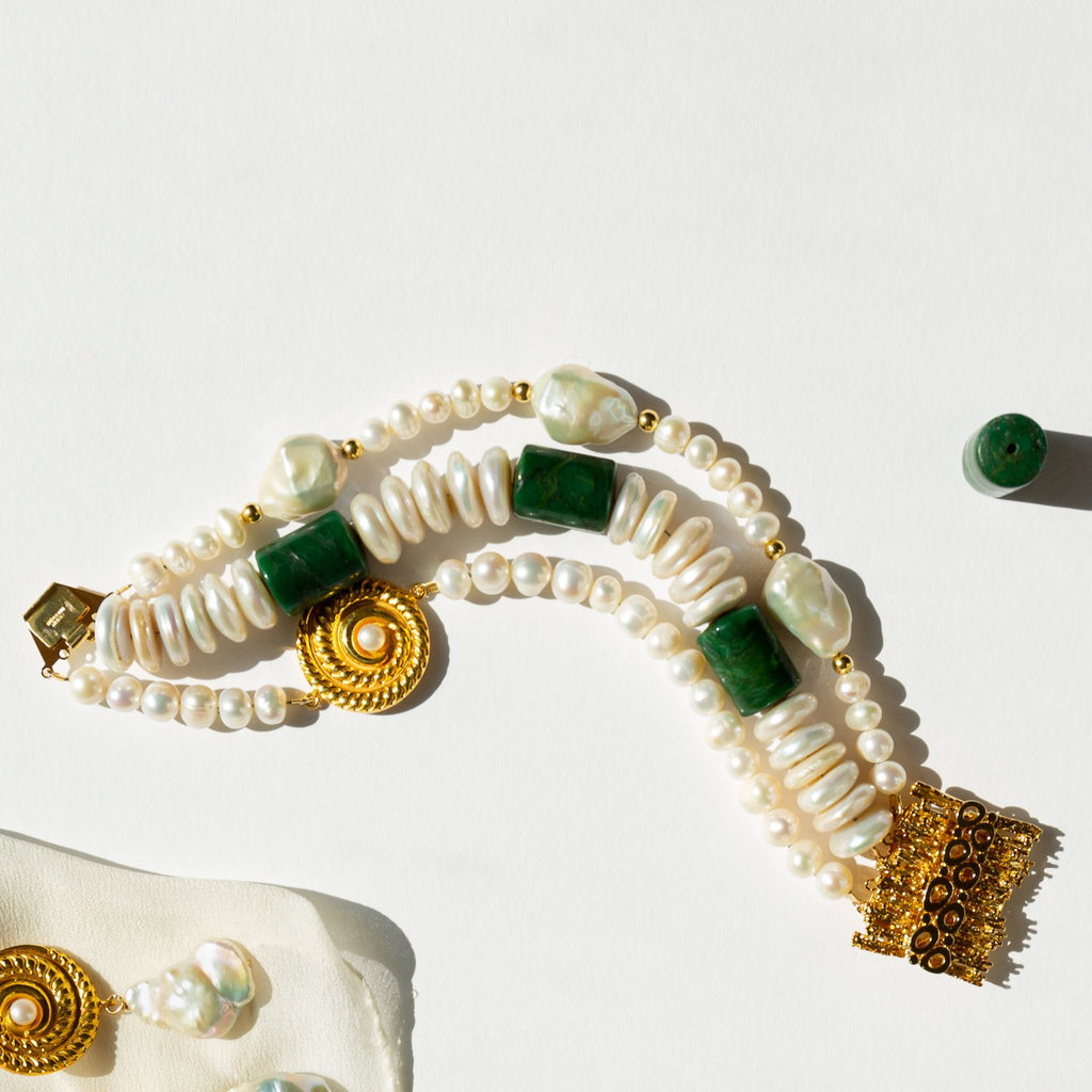 Enjoy the three raws of delicate and exciting pearls: shell, baroque and freshwater, gently embraced with jade and gold plated silver elements and clasp for that effortelessly beautiful look