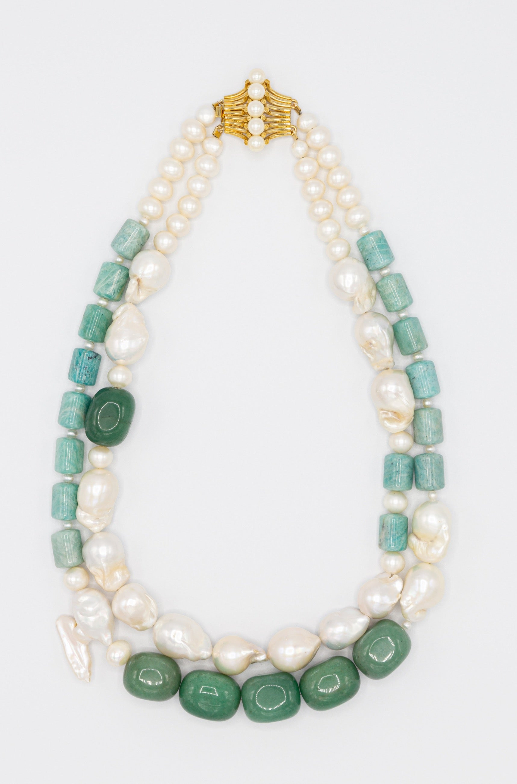Enjoy this fantastic duo necklace made of the high quality baroque, keishi and freshwater pearls, jade and amazonite beads, crystal quartz, finished with remarkable gold plated silver clasp. The brilliant shades of green are the distinguishing feature of this elegant yet cheerful assemble.