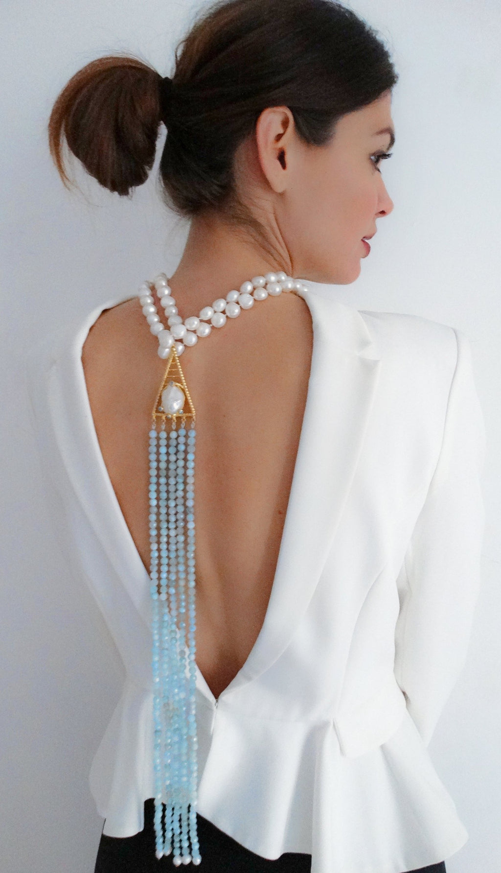 Re-establish the link between the nature and elegance with this complex yet stylish necklace ideal for sensual summer nights accompanied even with the simple white dress. Features aquamarine faceted beads, baroque and freshwater pearls, topaz  and gold plated silver ornament