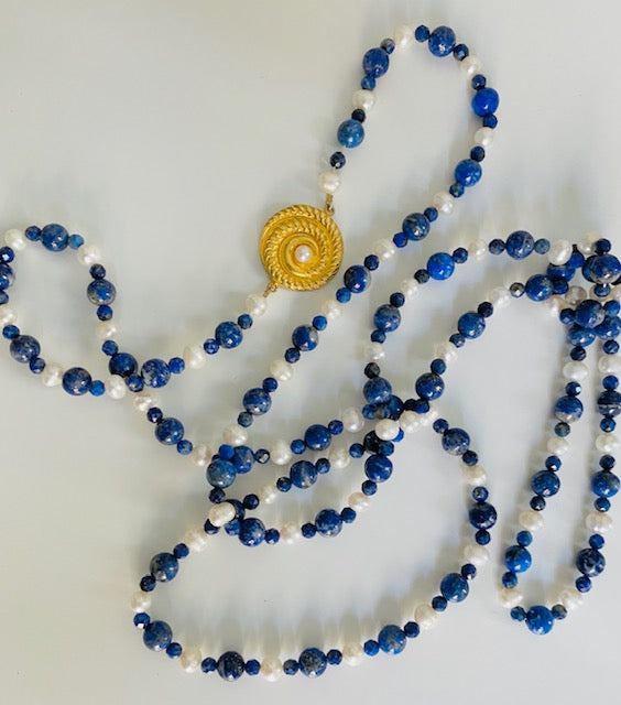 Necklace that one can wear in one, two or three raws is made of freshwater pearls, lapis lazuli and gold plated silver ornament. The reminescence of simplicity and style inspired by everlasting and effortless elegance
